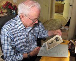 schaeffer looking at photo