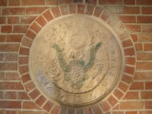 defaced great seal of usa on embassy