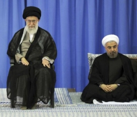 Iran rouhani sits below Supreme