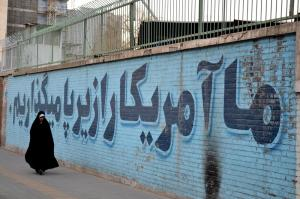 Iran woman walks past We put America under our foot